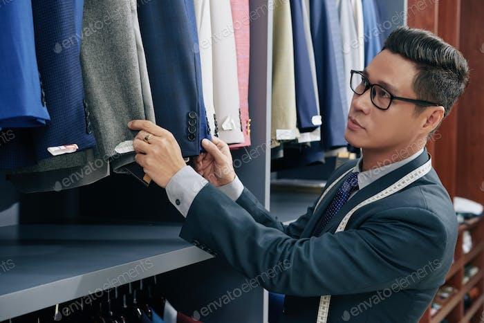 Salesman working in store