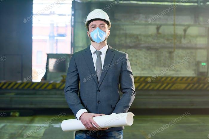 Businessman Posing at Plant