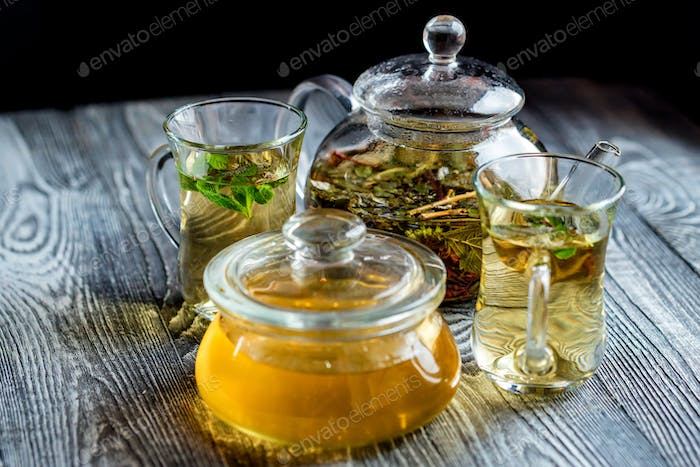 Herbal tea with honey and mint leaves