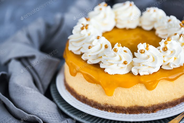 Delicious mango cheesecake decorated with whipped cream