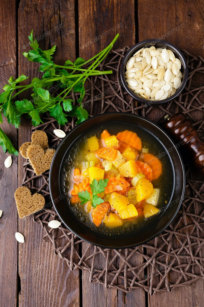 Vegetable soup with carrot, potato and pumpkin. Healthy vegetarian food