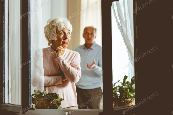 Woman giving husband silent treatment