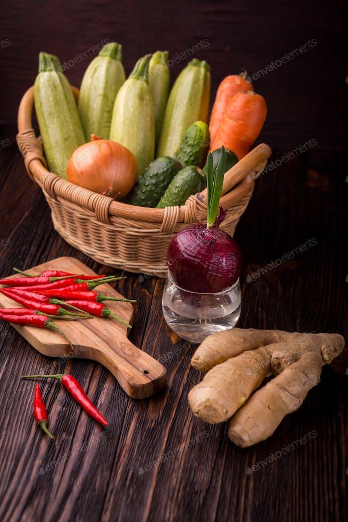 Raw detox green vegetable food set on wood table
