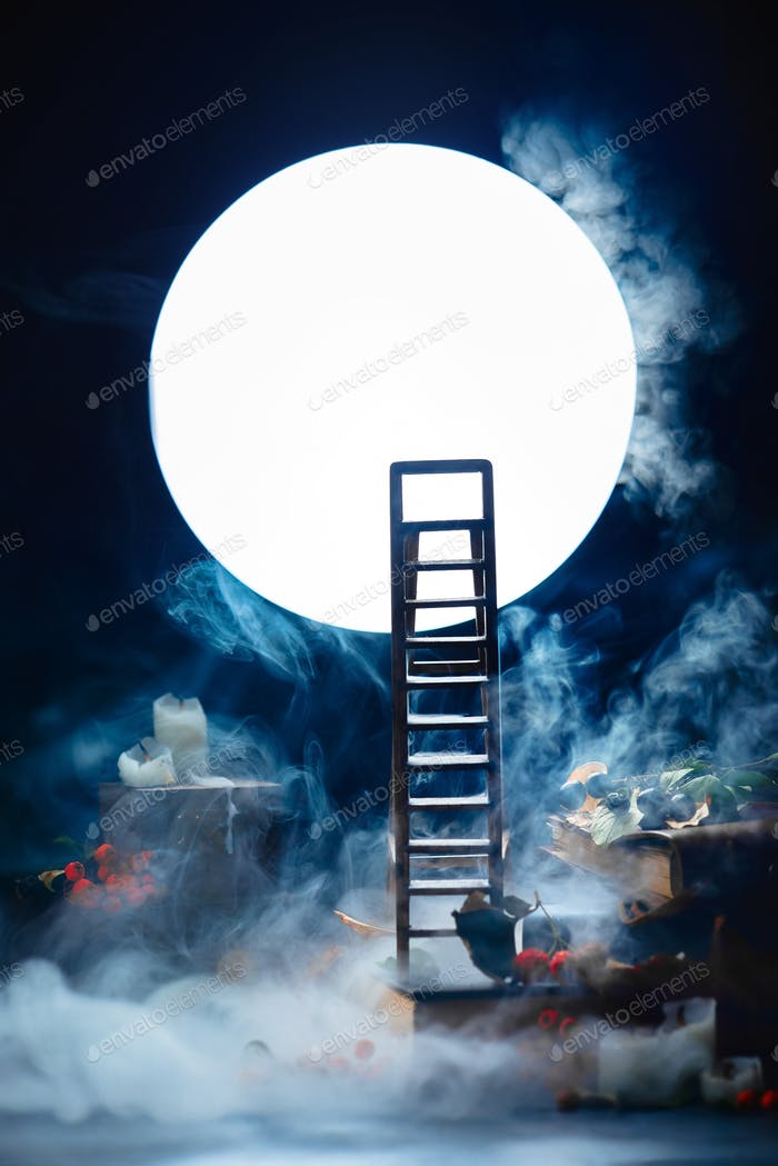 Ladder to the Moon. Conceptual still life with smoke, night scene with candles and books.