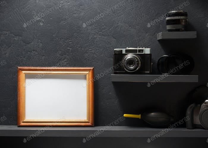 old camera at shelf wall wood