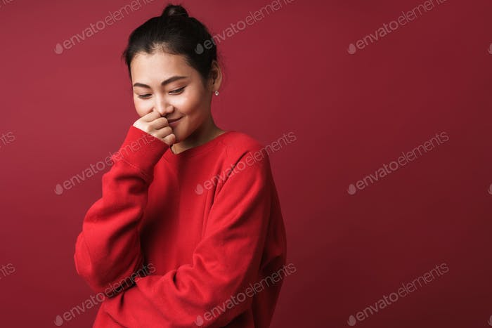 Cheerful happy young woman posing isolated