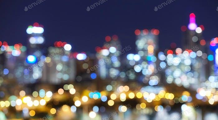 Blurred Denver skyline city lights at night.