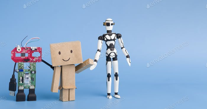 Three robots made with different materials on blue background, free space