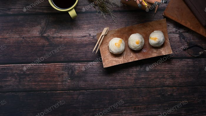 Top view of Chinese pastry or moon cake on wood dish and wood table with copy space.