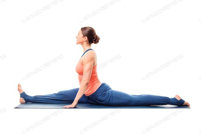Woman doing Hatha Yoga asana Hanumanasana splits