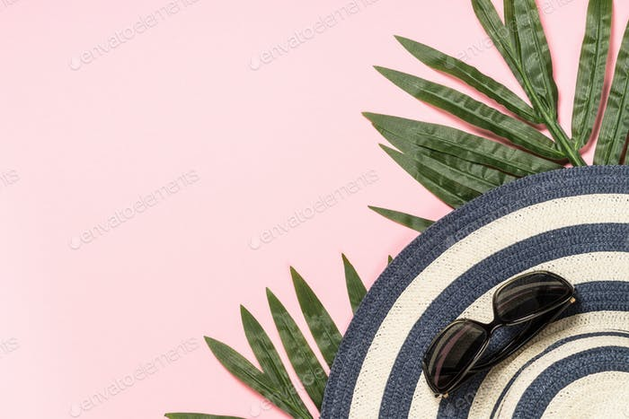 Summer holiday vacation background with palm leaves and hat