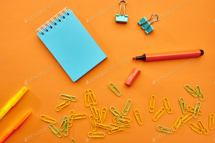 Clips, notepad and marker closeup, stationery