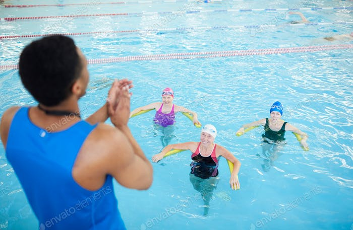 Fitness Class in Swimming Pool