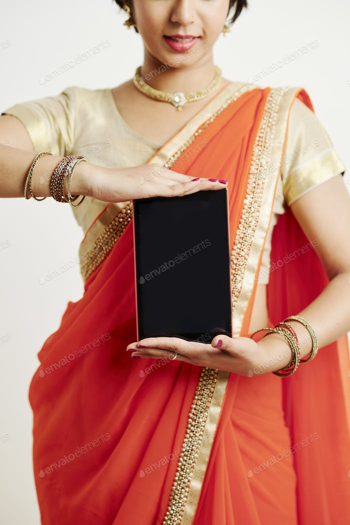 Indian woman showing digital tablet