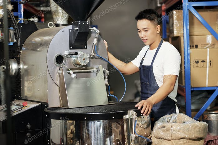 Man roasting coffee at manufacture