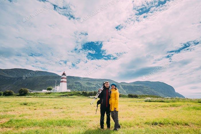 Alnesgard, Godoya, Norway. Man And Woman Young Adult Caucasian Tourists Travelers Couple Posing