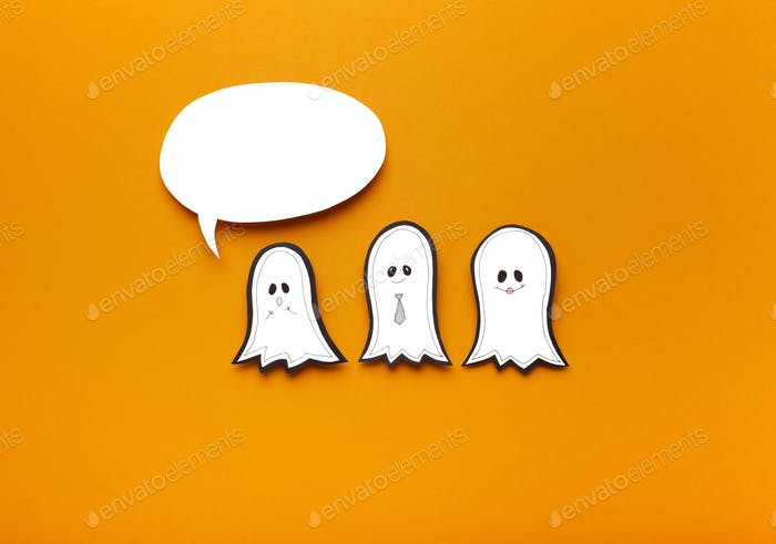 Empty speech bubble for text and three cute ghosts on orange