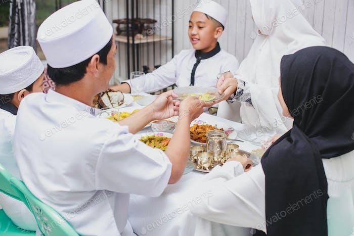 Happy Muslim Family Celebrating Eid Mubarak