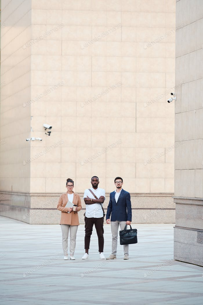 Serious young business interns in financial district