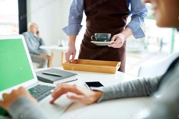 Unrecognizable Waiter Serving Coffee
