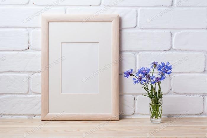 Wooden frame mockup with cornflower
