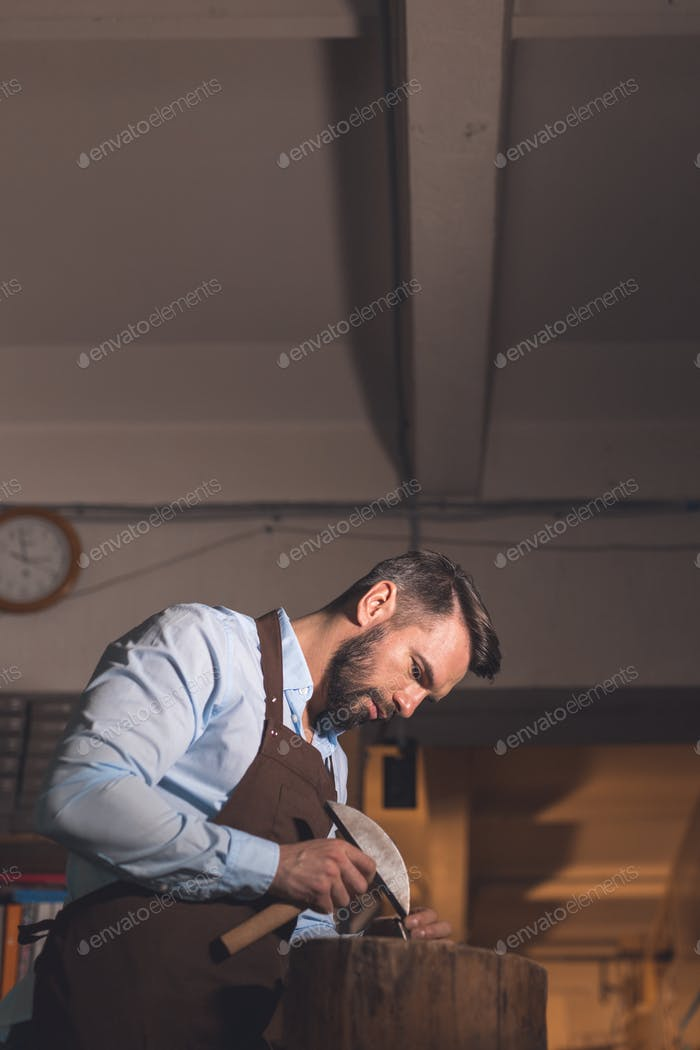 Young man in workshop
