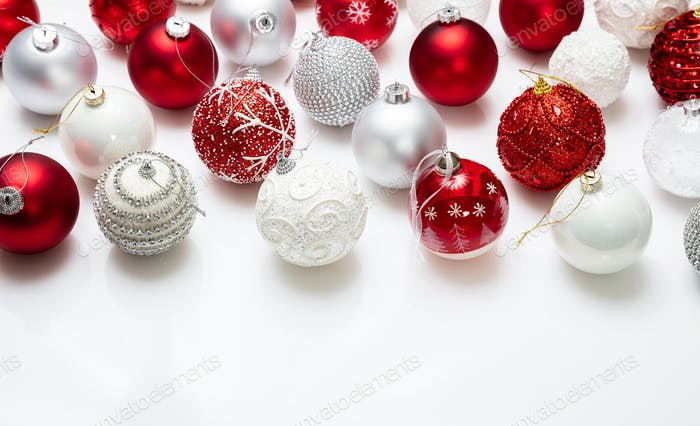 Xmas baubles close up against white background