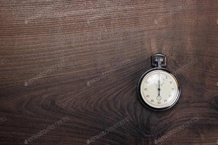 Stopwatch Over Brown Wooden Background