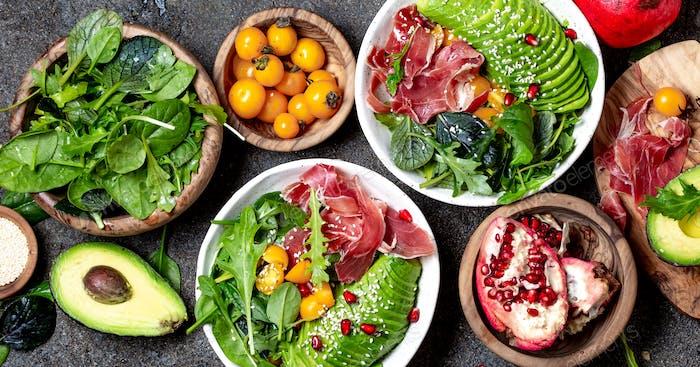 Fresh salad with green spinach, rucola, avocado an ham serrano