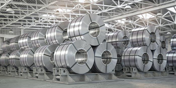 Rolls of metal sheet. Zinc, aluminium or steel sheet rolls on warehouse in factory.