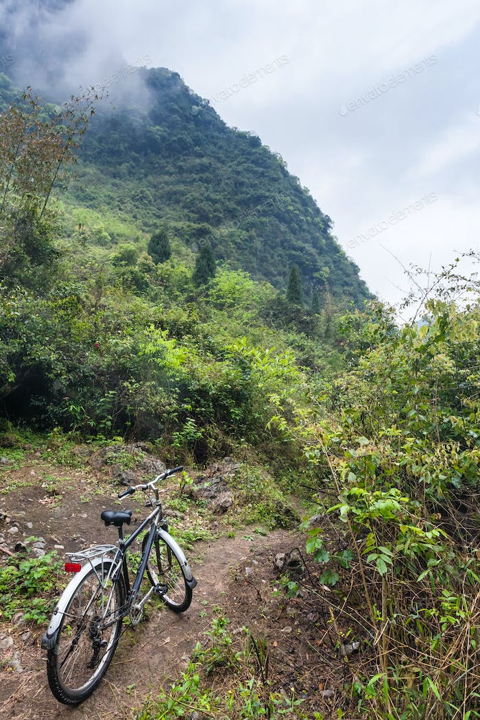 bicycle on between mountain peaks in Yangshuo