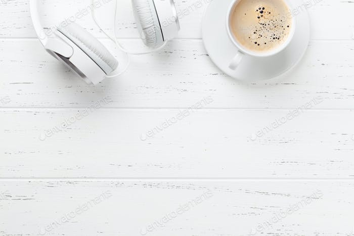 White headphones and coffee cup