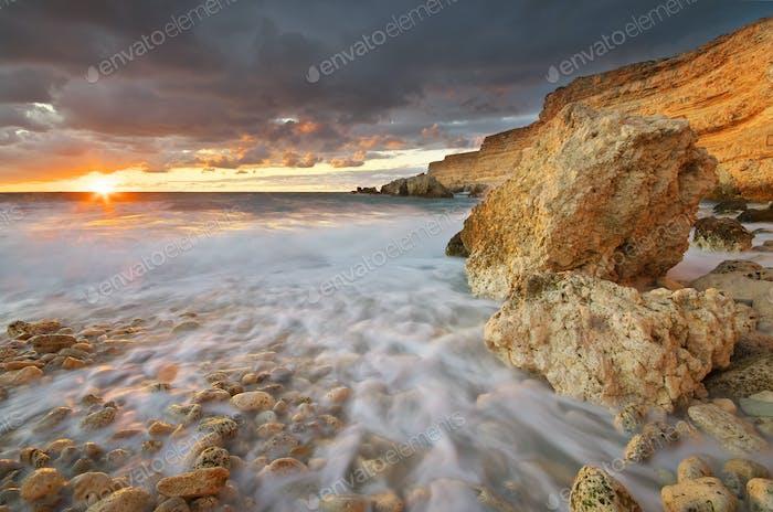 Sea and rocks at sunset.