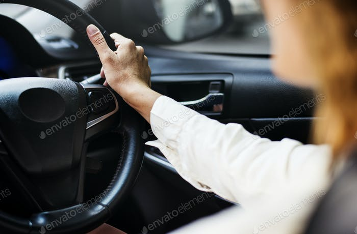 Woman driving a car on a road