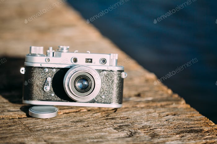 35mm Vintage Old Retro Small-Format Rangefinder Camera On Old Wo