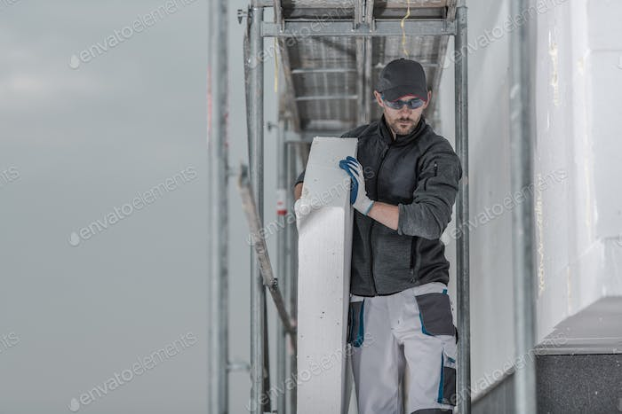 Worker with Piece of Insulation