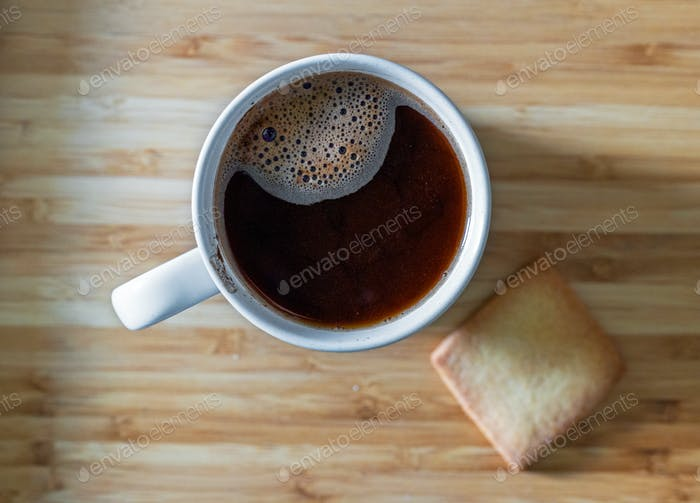 cup of black coffee and cookie