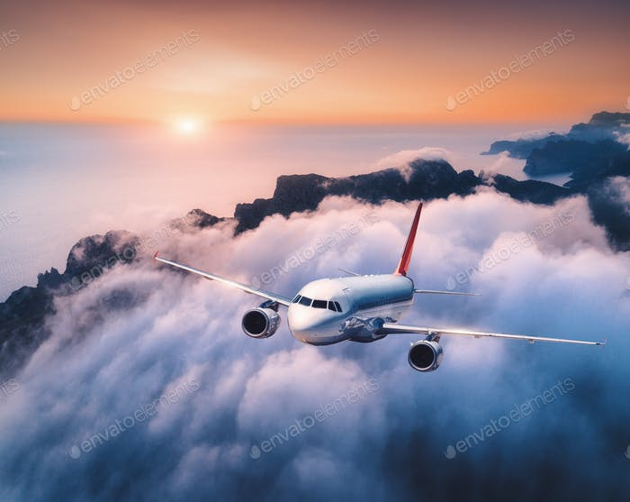 Thumbnail for Passenger airplane is flying over clouds at sunset