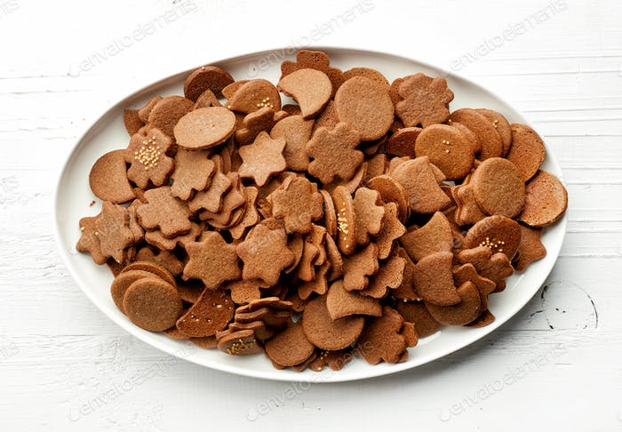 freshly baked gingerbreads on white plate