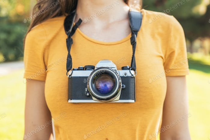 Close up of a photographer with her camera.