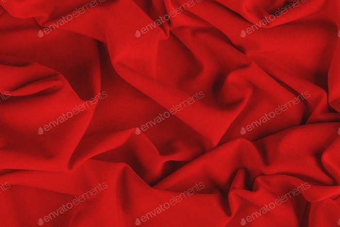 Smooth elegant red draped fabric. Background, texture