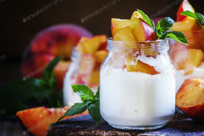Dessert with sweet peaches, cottage cheese and whipped cream