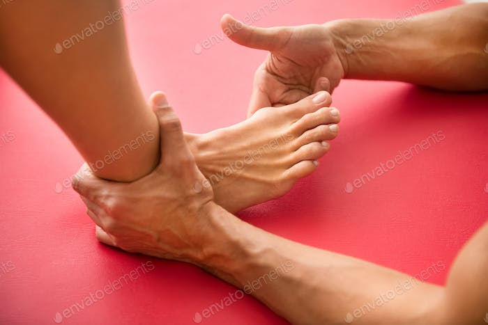 Osteopath assessing a hallux valgus