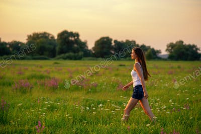 Young woman is walking on nature