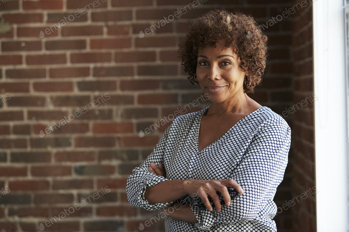 Head And Shoulders Portrait Of Mature Businesswoman