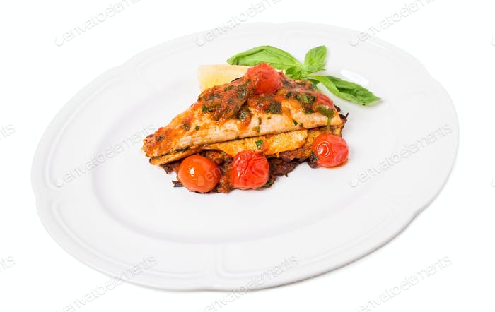 Grilled dorado covered with baked vegetables.