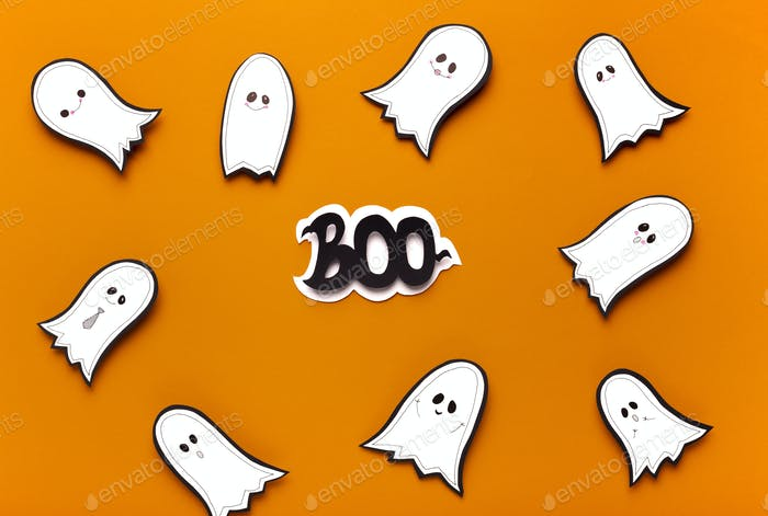 Spooktacular Halloween ghosts flying on orange background