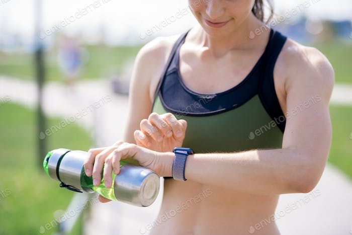 Active Woman Checking Smart Watch