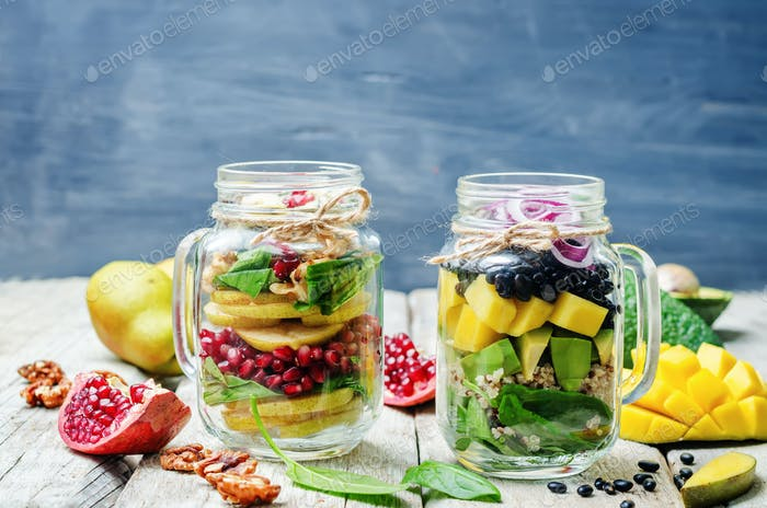 homemade healthy salads with vegetables, fruits, beans and quino