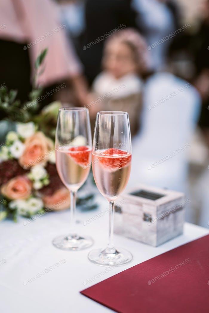 Strawberry in champagne in glasses